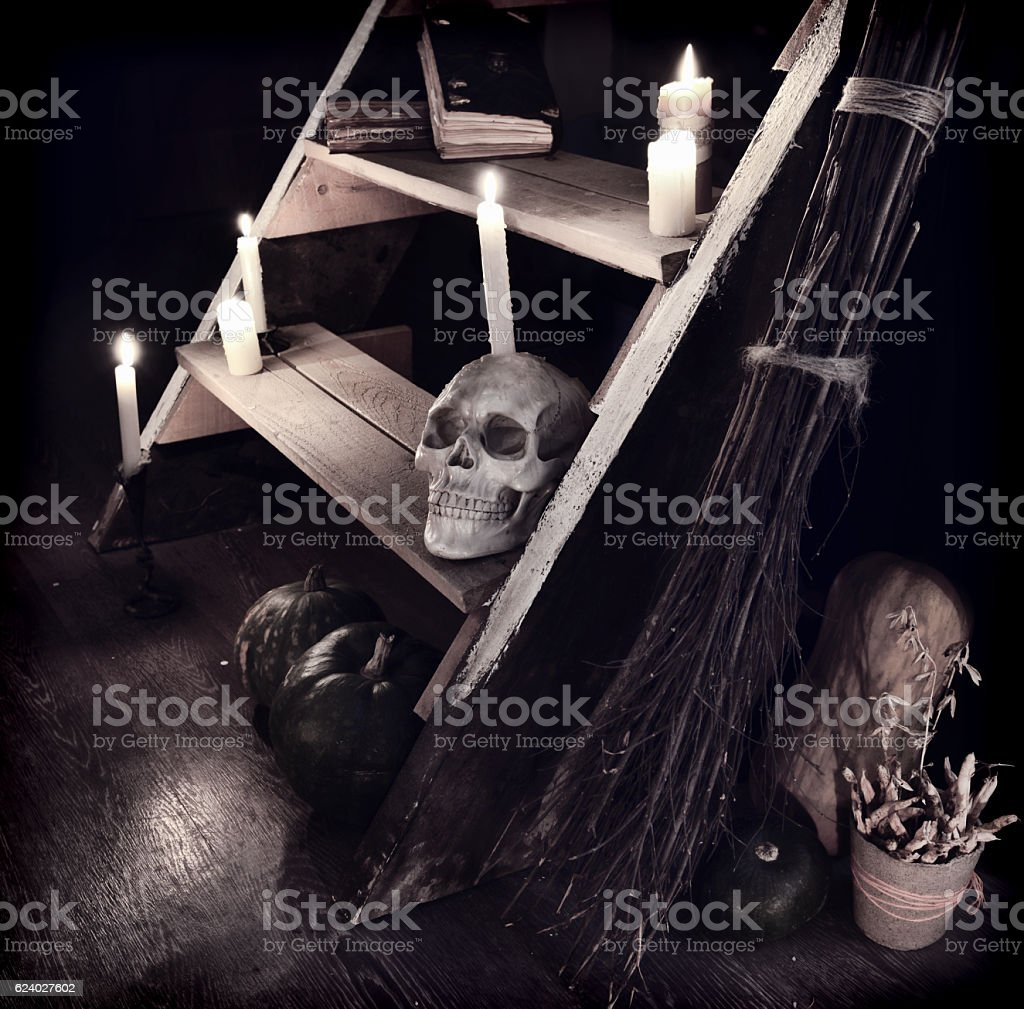 Still life with skull and evil staircase in witch house stock photo