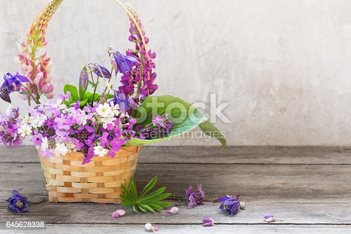 istock still life with summer flowers in basket 645628338