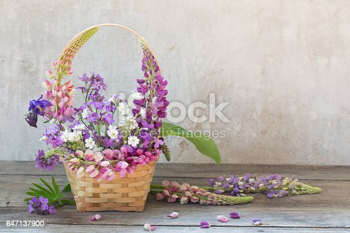 istock still life with summer flowers in basket 647137900