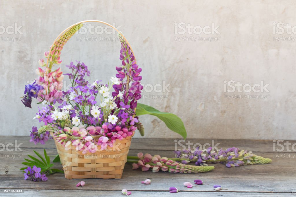 still life with summer flowers in basket stock photo