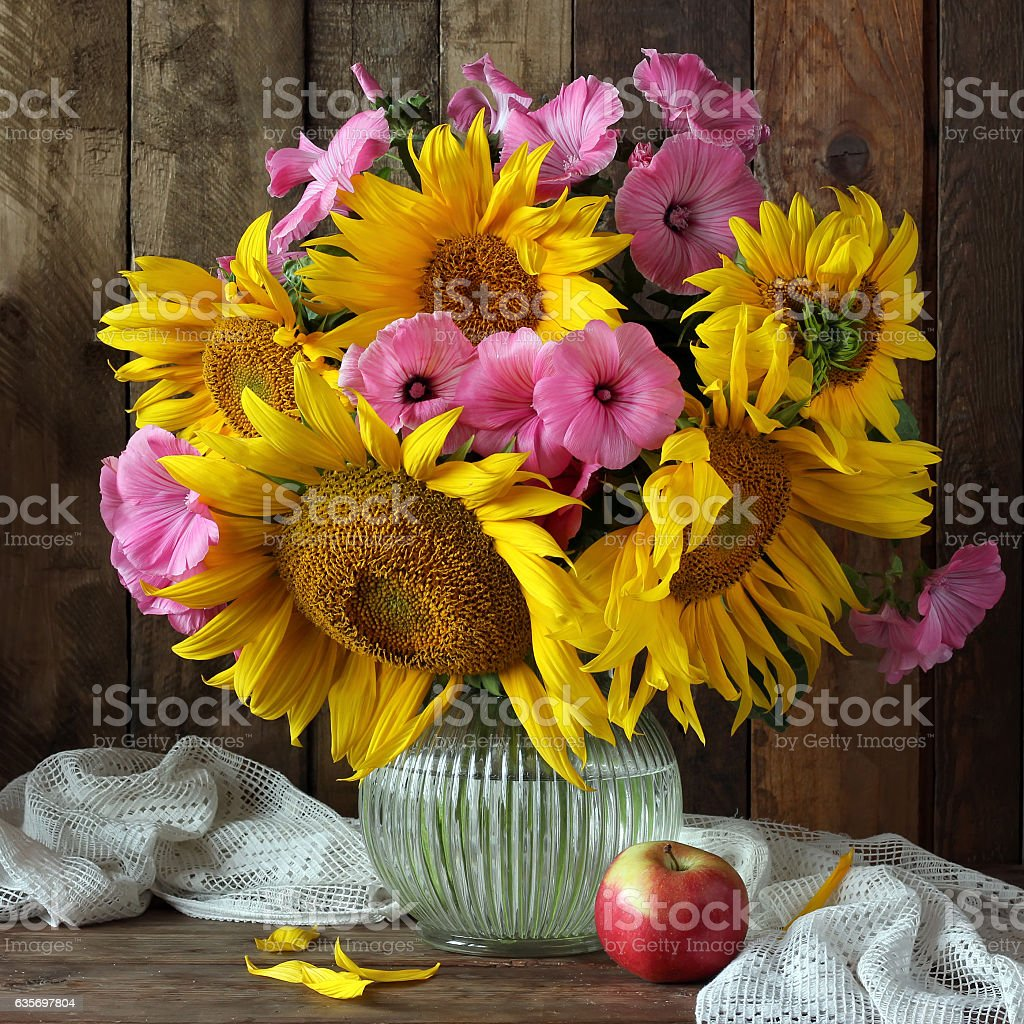 Still life with sunflowers in a rustic style. royalty-free stock photo