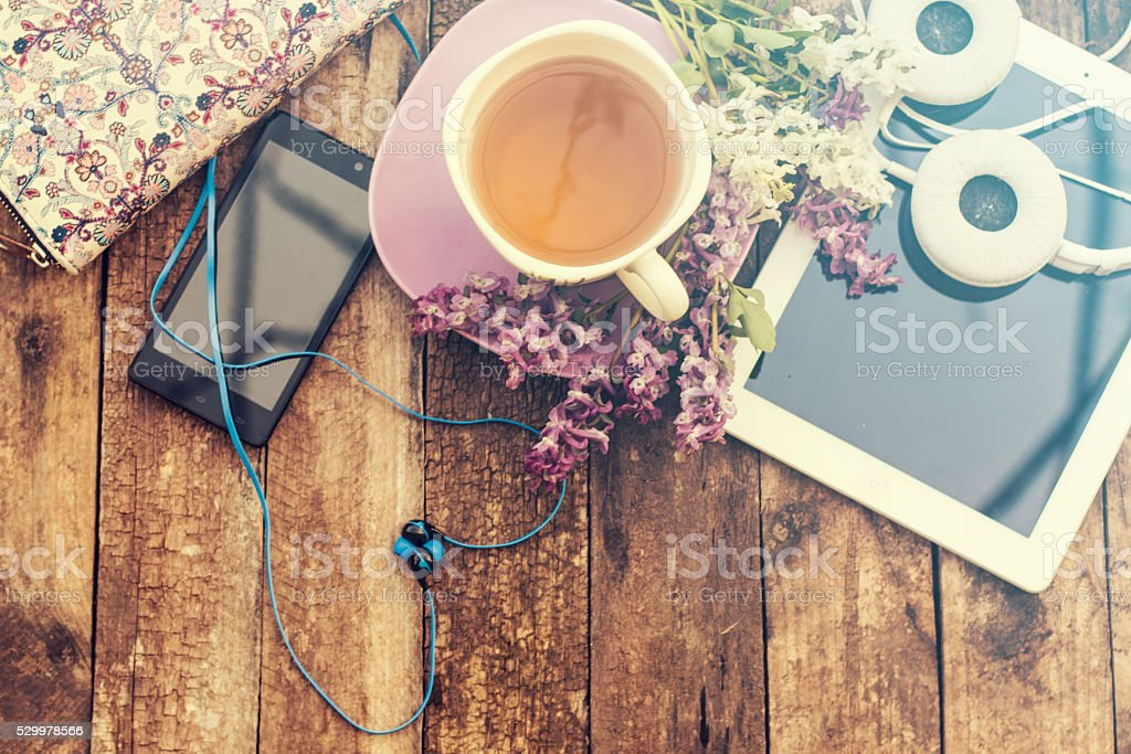 still life with tea cup on a wooden table stock photo
