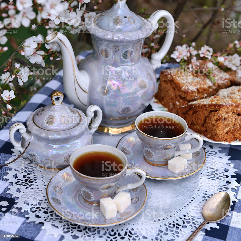 Still life with tea set and cake on white napkin stock photo