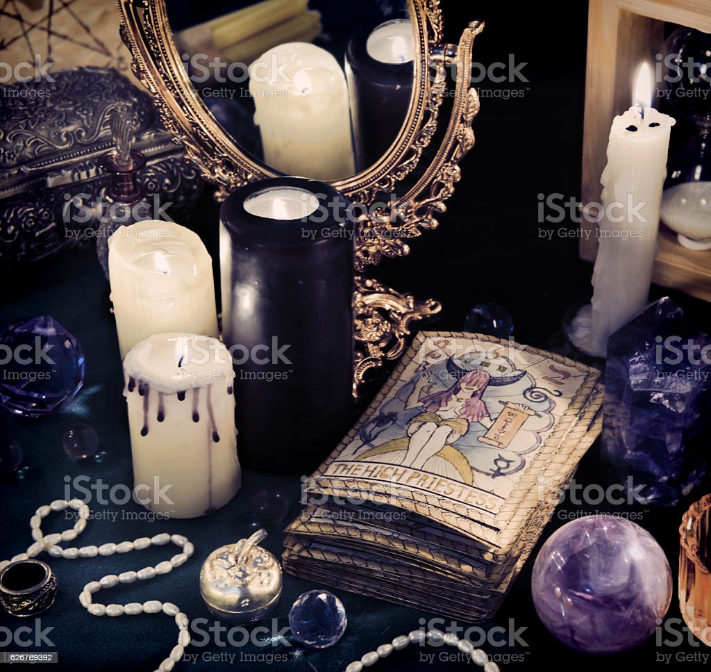 Still life with the Tarot cards, mirrow and candles stock photo