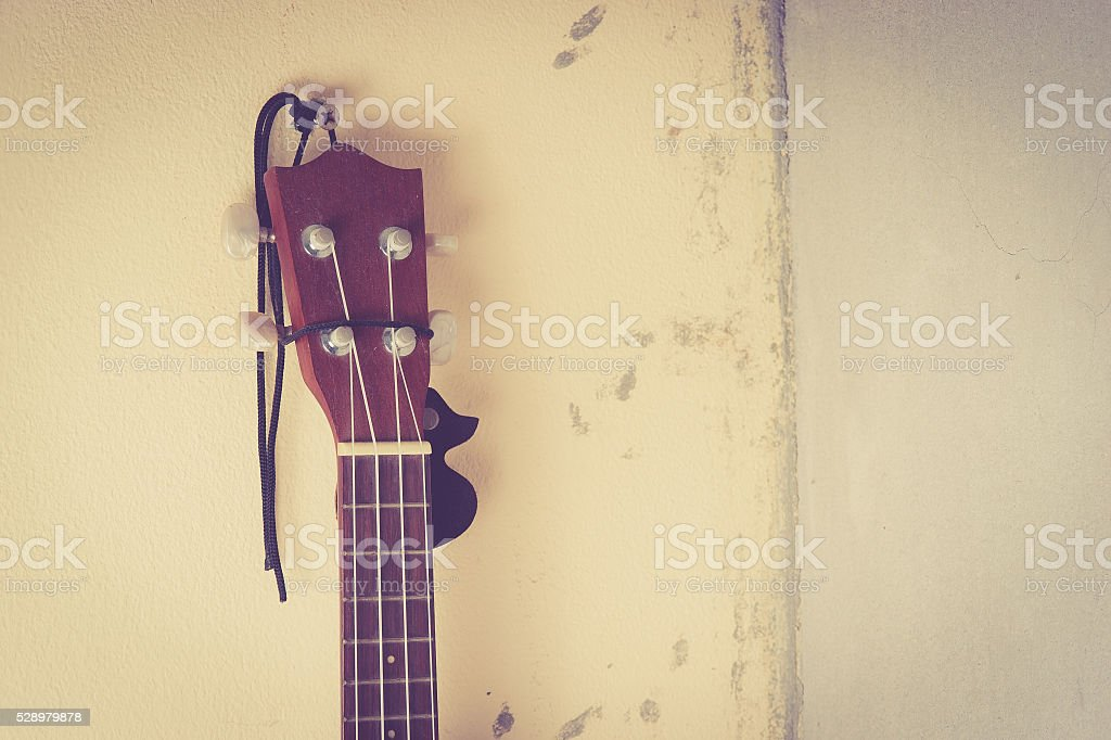Still life with ukulele Old on the wall stock photo