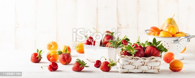 istock Still life with various types of fresh fruits and berries 1153081194