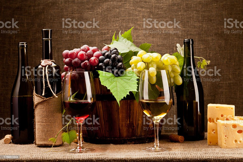 Still life with wine bottles, glasses and grapes royalty-free stock photo