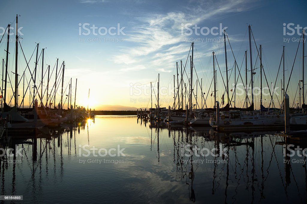 Still shot of boats in marina at sunset royalty-free stock photo