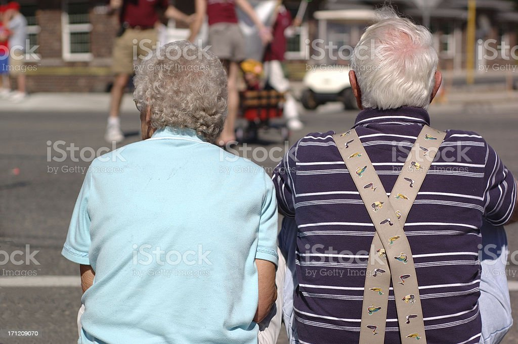 Still together, watching parade. stock photo
