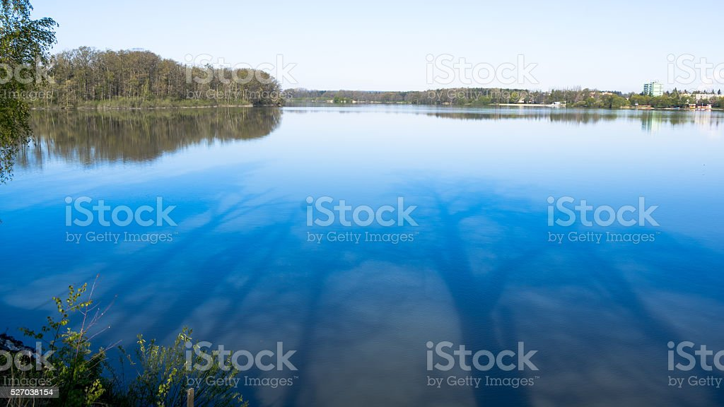 Still water of the pond and mirroring images stock photo