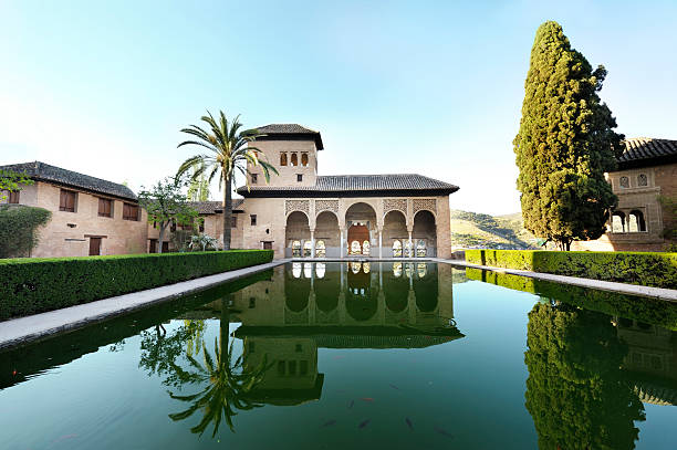 Still waters outside the Alhambra Palace, Granada, Spain stock photo