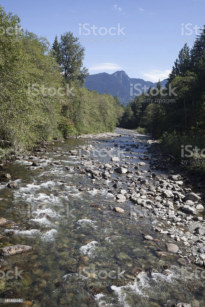 Stillaguamish River Flowing and Cascade Mountains stock photo