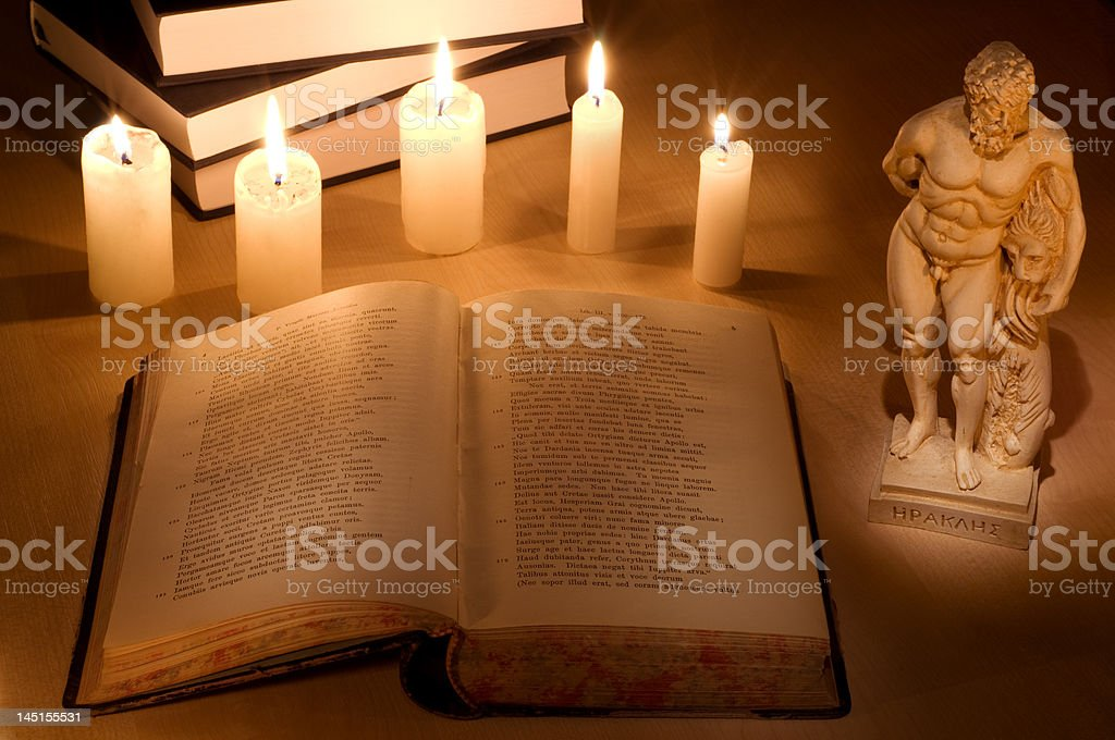 Still-life with an old Latin book royalty-free stock photo