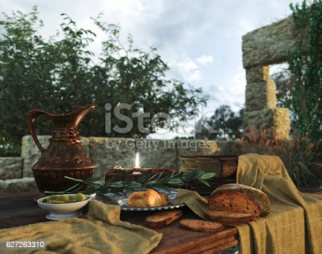 istock stilllife with ancient ruins, books,bread olive and pitcher 627263310