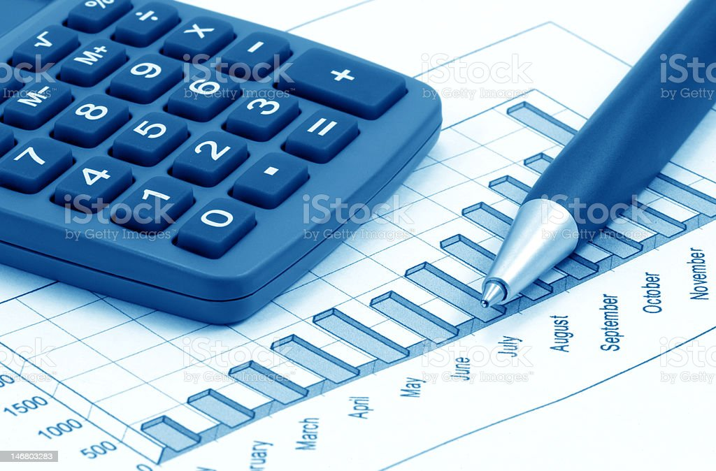 Still-life with calculator, pen and diagram (blue toned) royalty-free stock photo