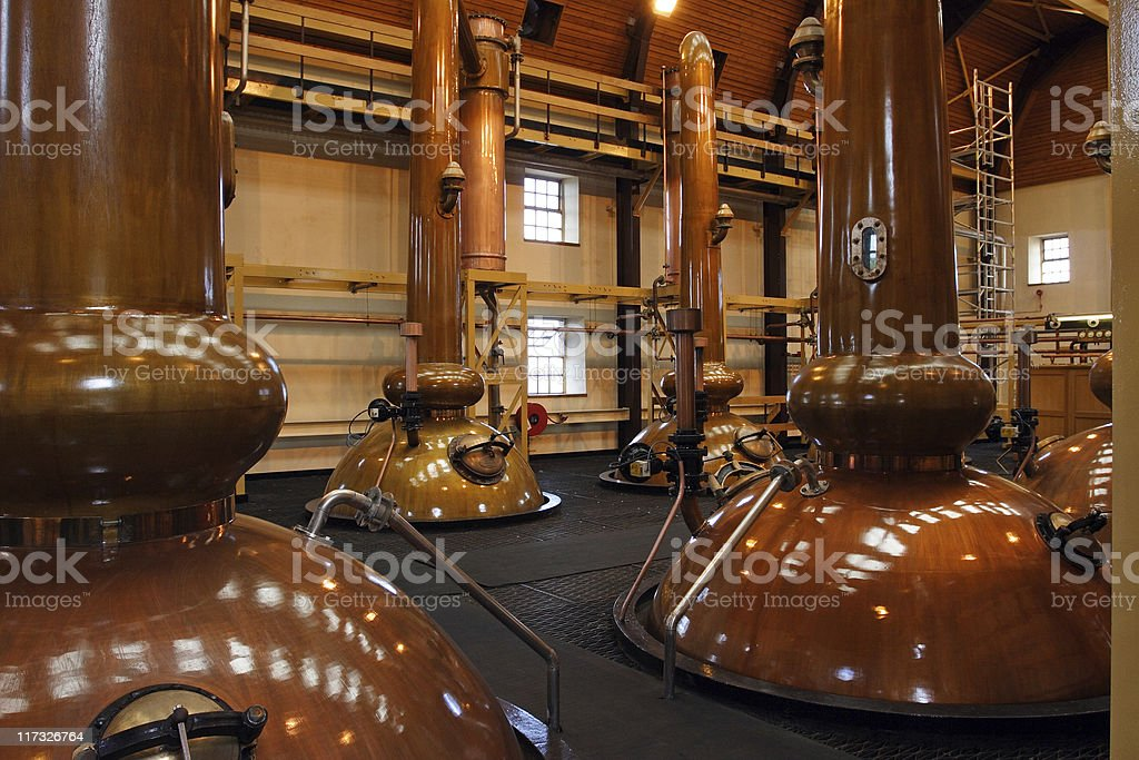 Stills in a whisky distillery stock photo