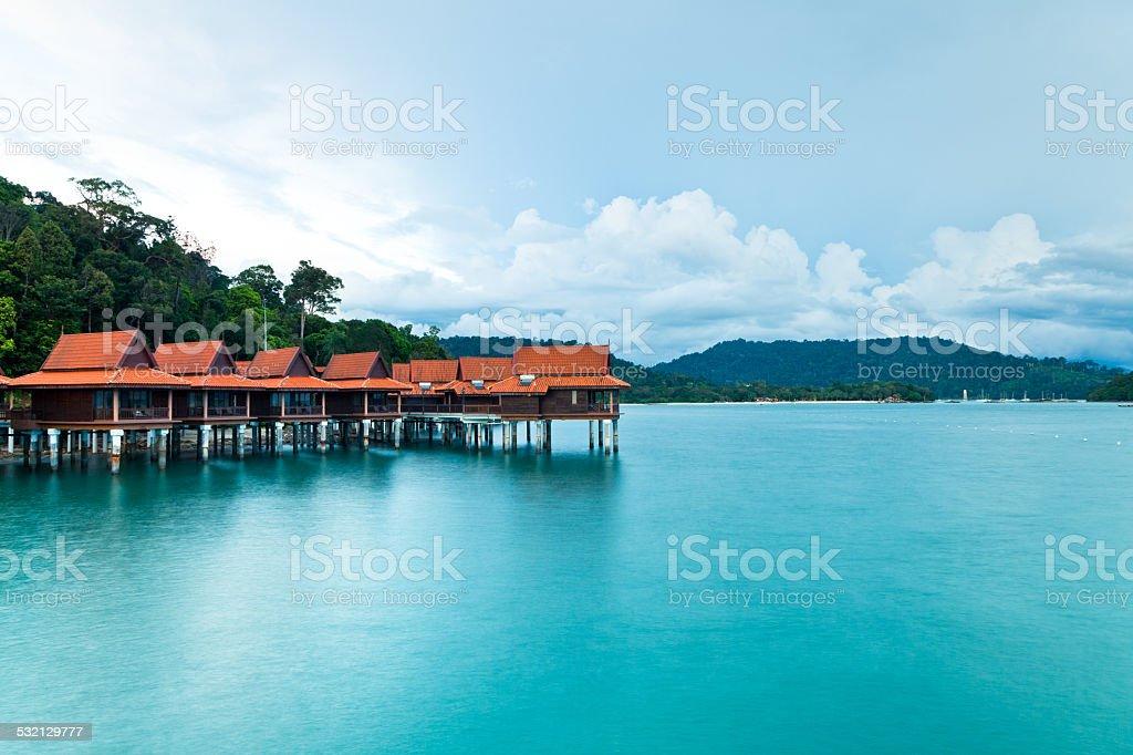 Stilt bungalows on the shore of Andaman sea stock photo