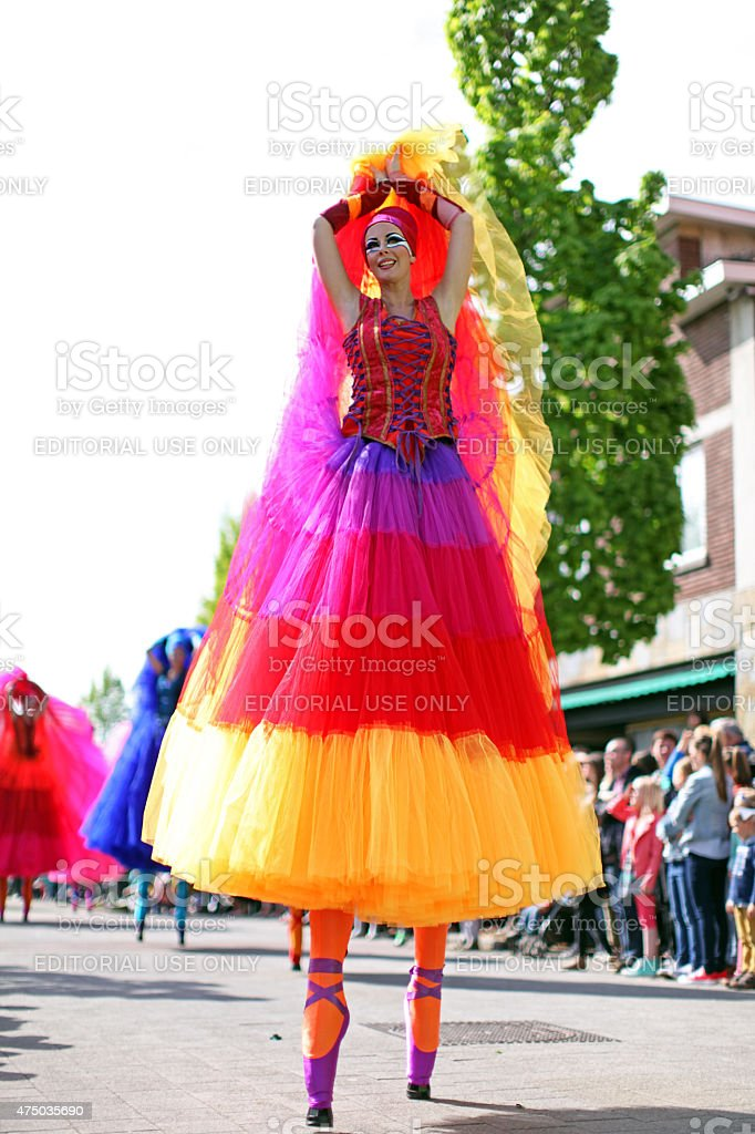 Stilt Dancer at May Day Parade in Genk Belgium stock photo