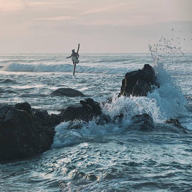 Stilt Fisherman in Weligama, Sri Lanka stock photo