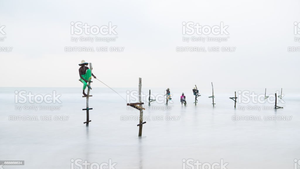 Stilt fisherman, Weligama Beach, Sri Lanka. stock photo