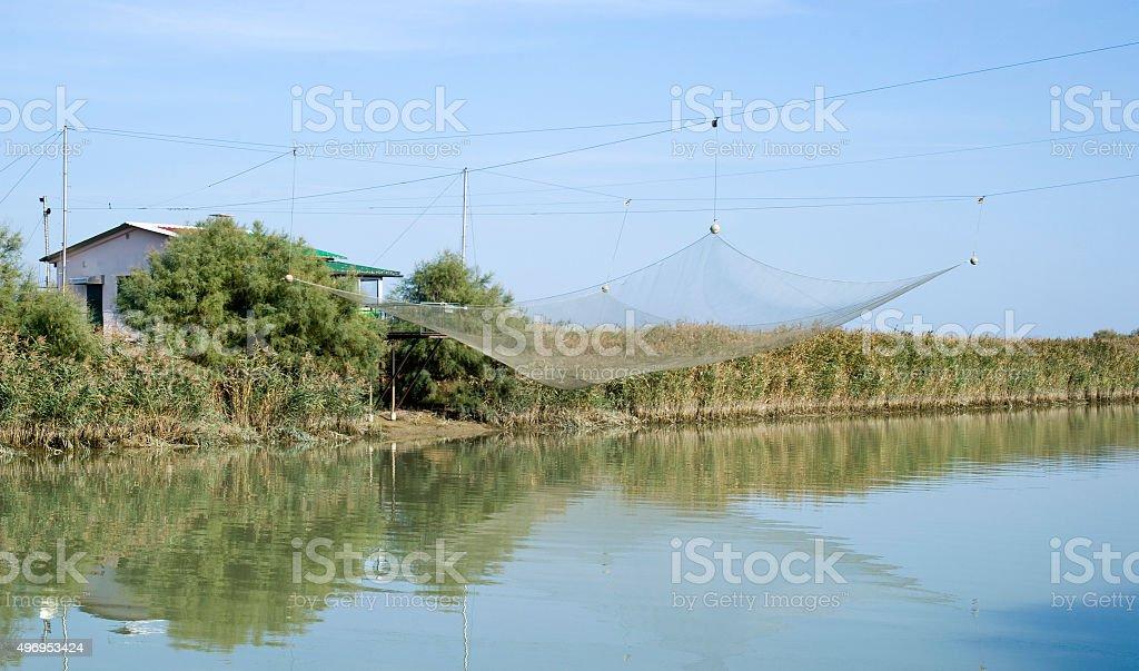 Stilt house and fishing nets along the Po Delta. Italy stock photo