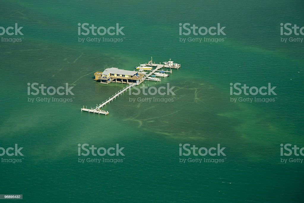 Stilt house and pier in the ocean royalty-free stock photo