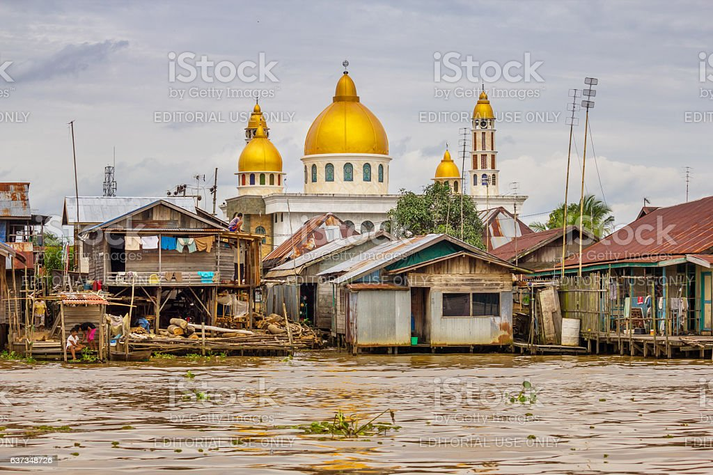 stilt houses and mosque in banjarmasin south kalimantan province indonesia royalty free stock photo