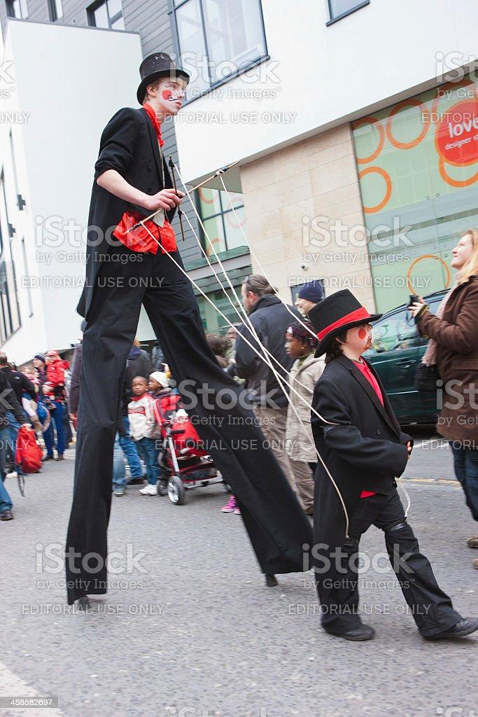 Stilt walker with a pretend puppet stock photo