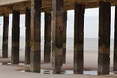 Stils of pier at North Sea in Blankenberge