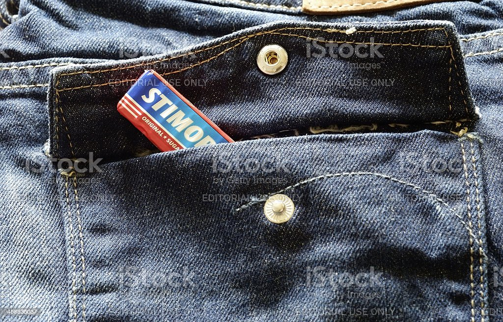 Stimorol chewing gum packet in blue jeans pocket
