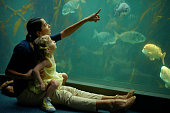 A mom and daughter spend time looking at the fish at the aquariumhttp://195.154.178.81/DATA/i_collage/pi/shoots/783341.jpg