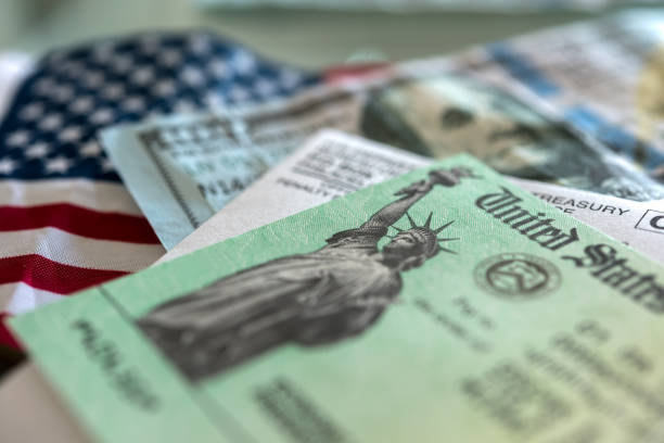 Stimulus check arrived Stimulus check: a check from the US government to ease the domestic economy during tough times of pandemics and economic crises. stimulus check stock pictures, royalty-free photos & images