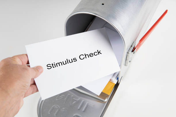Stimulus Check in the Mailbox A person retrieves their stimulus check from the mailbox. Mailbox in on white background. stimulus check stock pictures, royalty-free photos & images