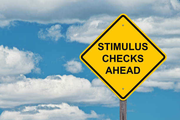 Stimulus Checks Ahead Waring Sign Stimulus Checks Ahead - Caution Sign Blue Sky Background stimulus check stock pictures, royalty-free photos & images