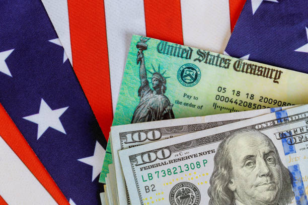 stimulus economic tax return check and us 100 dollar bills currency with us flag - bills and taxes stock pictures, royalty-free photos & images