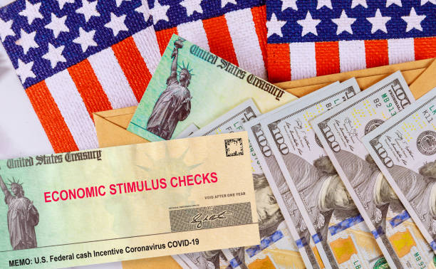 Stimulus financial a bill individual checks from government US 100 dollar bills currency American flag Global pandemic Covid 19 lockdown Stimulus financial bill individual checks from government US 100 dollar bills currency Global pandemic Covid 19 lockdown on American flag stimulus check stock pictures, royalty-free photos & images