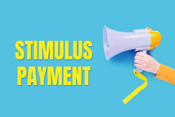 stimulus payment text with megaphone. Yellow on blue stimulus payment text with a megaphone in hand, Announcement. Yellow on blue. Stimulus package concept. Business support. stimulus check stock pictures, royalty-free photos & images
