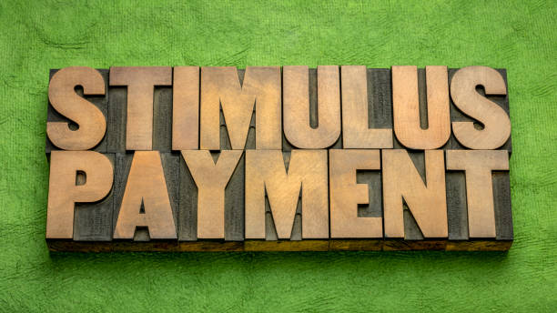 stimulus payment word abstract in wood type stock photo