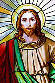 A close-up of a stained glass window depicting Jesus Christ, old church window from 1854, artist unknown, Czech Republic, full frame