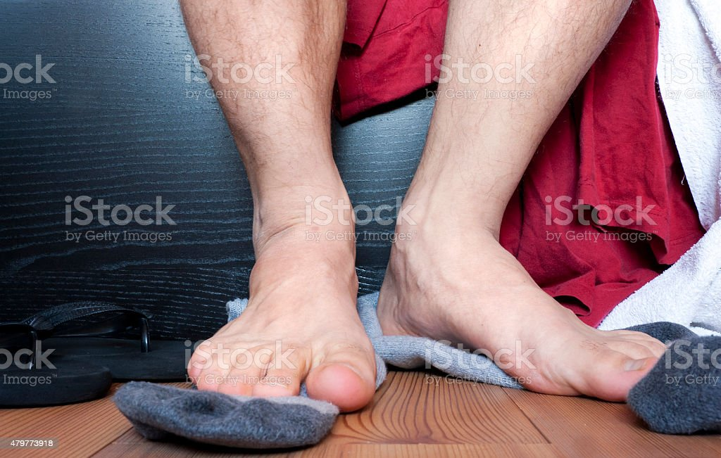 Stinky feet after workout stock photo