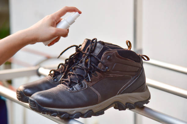 stinky hiking boot.Process of cleaning shoes stock photo