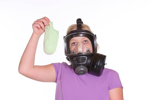 stinky sock and gas mask - kvinna ventilationssystem bildbanksfoton och bilder