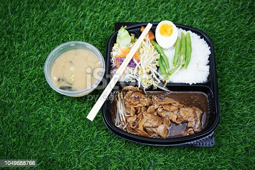 istock stir fried pork with boil egg in the box set and miso soup 1049688766