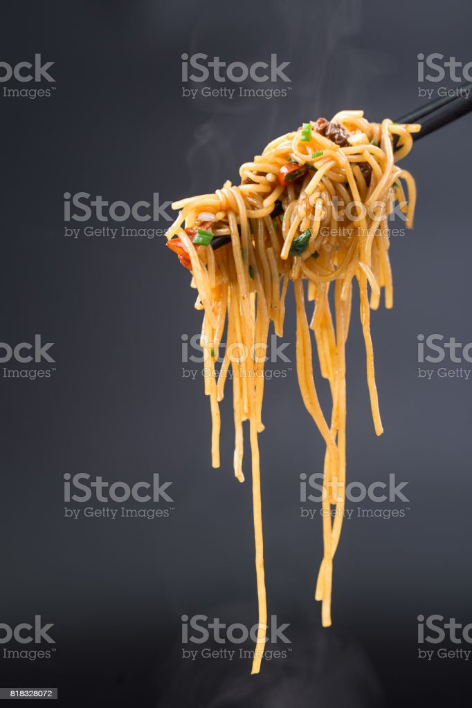 stir fried rice noodle with black background stock photo