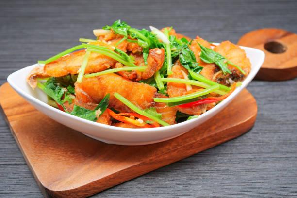 Stir fried sea bass with celery stock photo