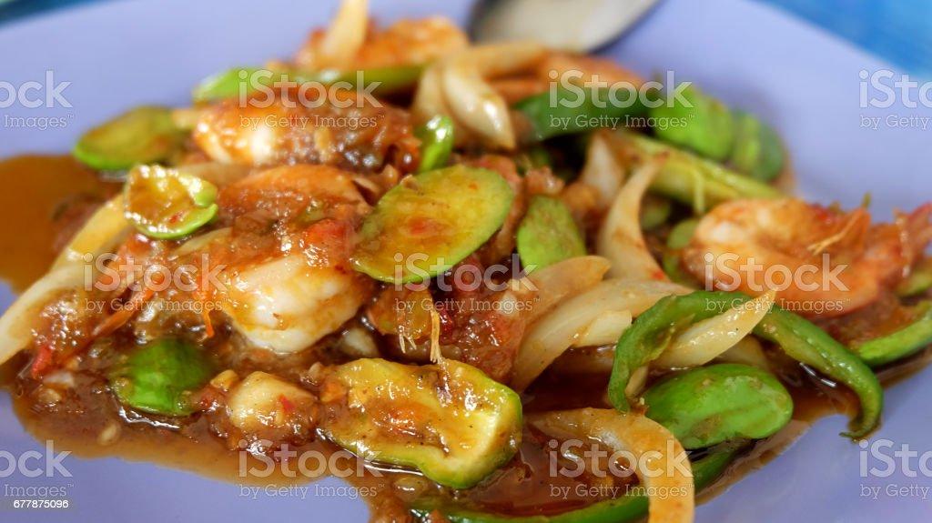 Stir Fried Shrimp with stink bean (bitter bean) ,Southern Thai cuisine. royalty-free stock photo