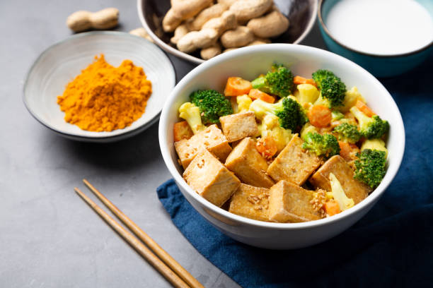 Stir fried tofu and vegetables with peanut sauce stock photo