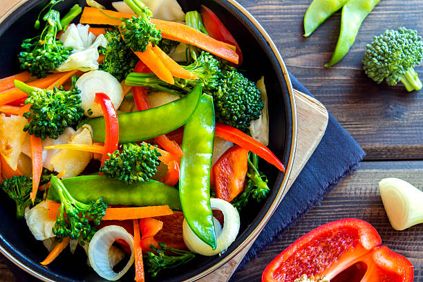 stir fried vegetables - vegetarian stock photos and pictures