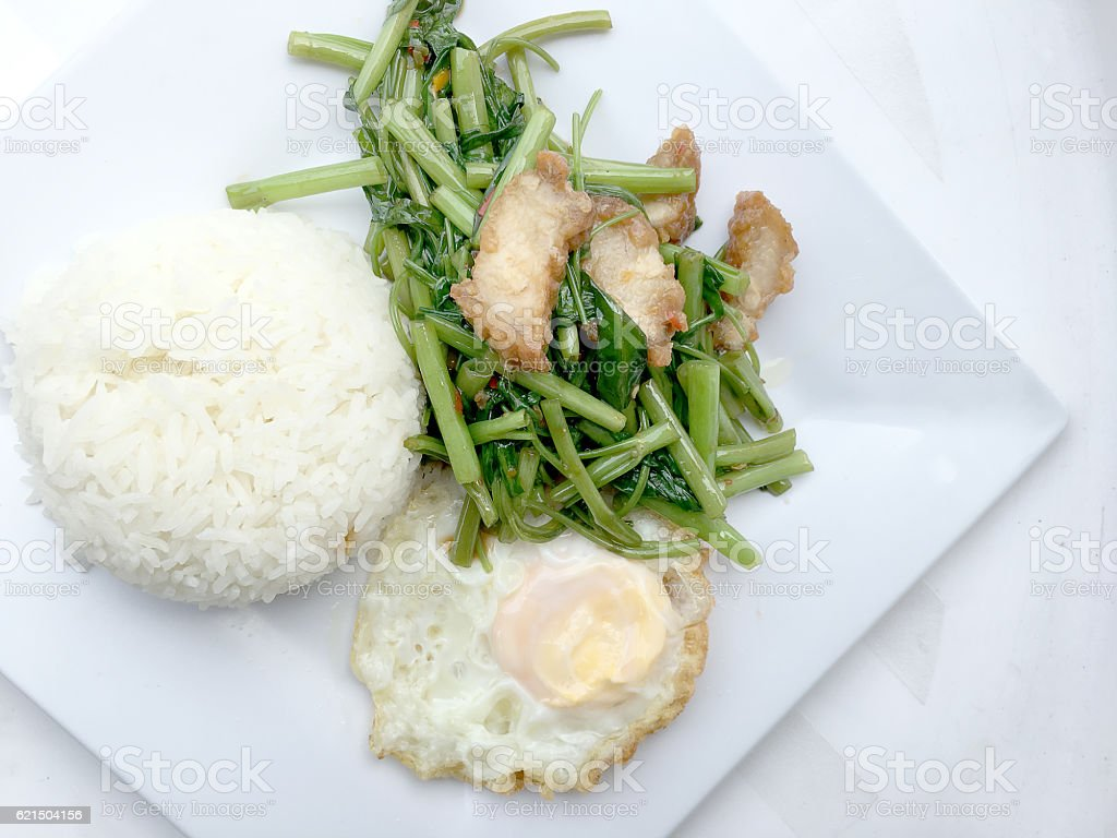 Stir Fried Water Spinach with chili and crispy pork stock photo