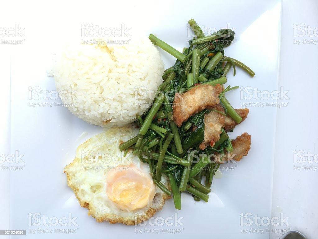 Stir Fried Water Spinach with chili and crispy pork Lizenzfreies stock-foto